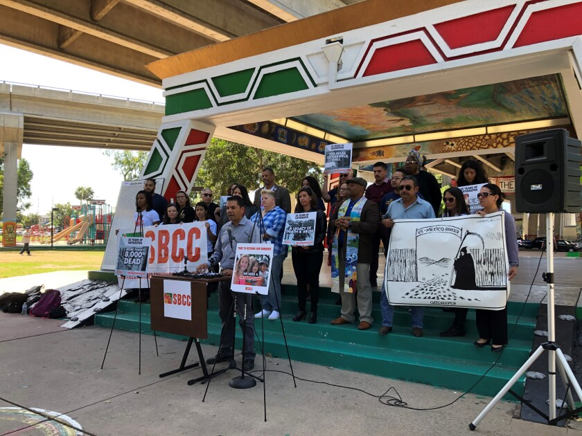 Members of the Southern Border Communities Coalition condemn Operation Gatekeeper and modern border policies on Oct. 1, 2019, on Gatekeeper's 25th anniversary at a Chicano Park news conference. Speaking is Pedro Rios, director of the U.S.-Mexico Border Program for the American Friends Service Committee.
