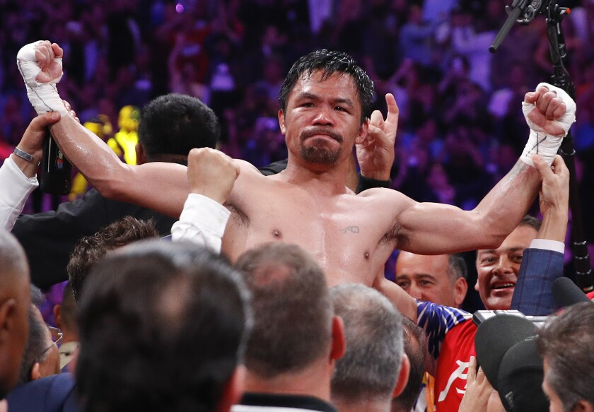 Manny Pacquiao celebrates after defeating Keith Thurman by split decision for the WBA welterweight title.