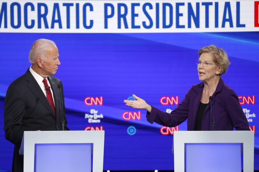 Democratic presidential candidate former Vice President Joe Biden and Sen. Elizabeth Warren, D-Mass., participate in a Democratic presidential primary debate hosted by CNN/ and the New York Times at Otterbein University, Tuesday in Westerville, Ohio.