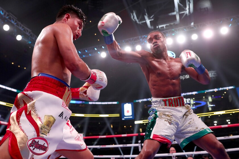 Errol Spence Jr., right, throws a punch at Mikey Garcia during their IBF world welterweight championship bout in March.