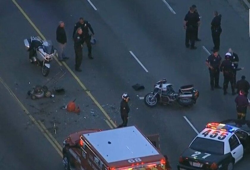 Aerial footage shows the crash in Mid-City in which an LAPD motorcycle officer was struck by a vehicle Wednesday morning.