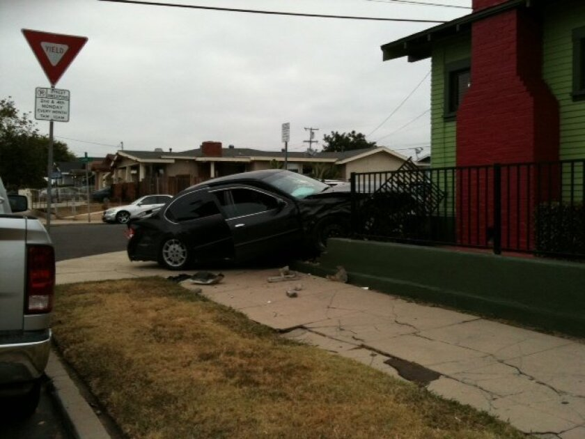 The driver of a black Maxima ran off after hitting another car, then a house, in City Heights.