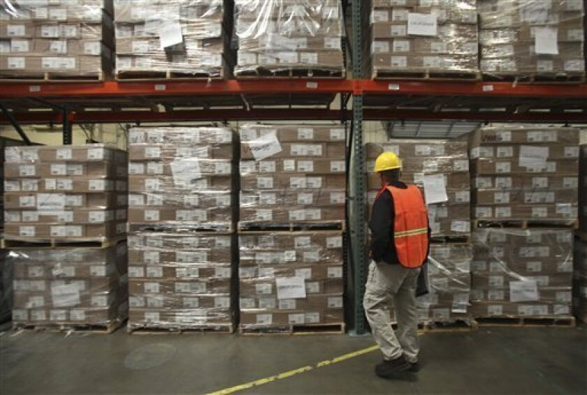 Boxes of swine flu antiviral is seen stored in a state warehouse in an undisclosed place near Sacramento, Calif., Thursday, April 30, 2009. (AP Photo/Rich Pedroncelli, Pool)
