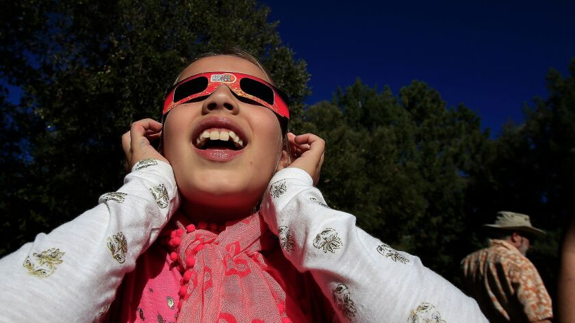 MT. WILSON, CA - OCTOBER 23, 2014: Eliza Monsalvez, 8, of Los Angeles, looks through solar glasses