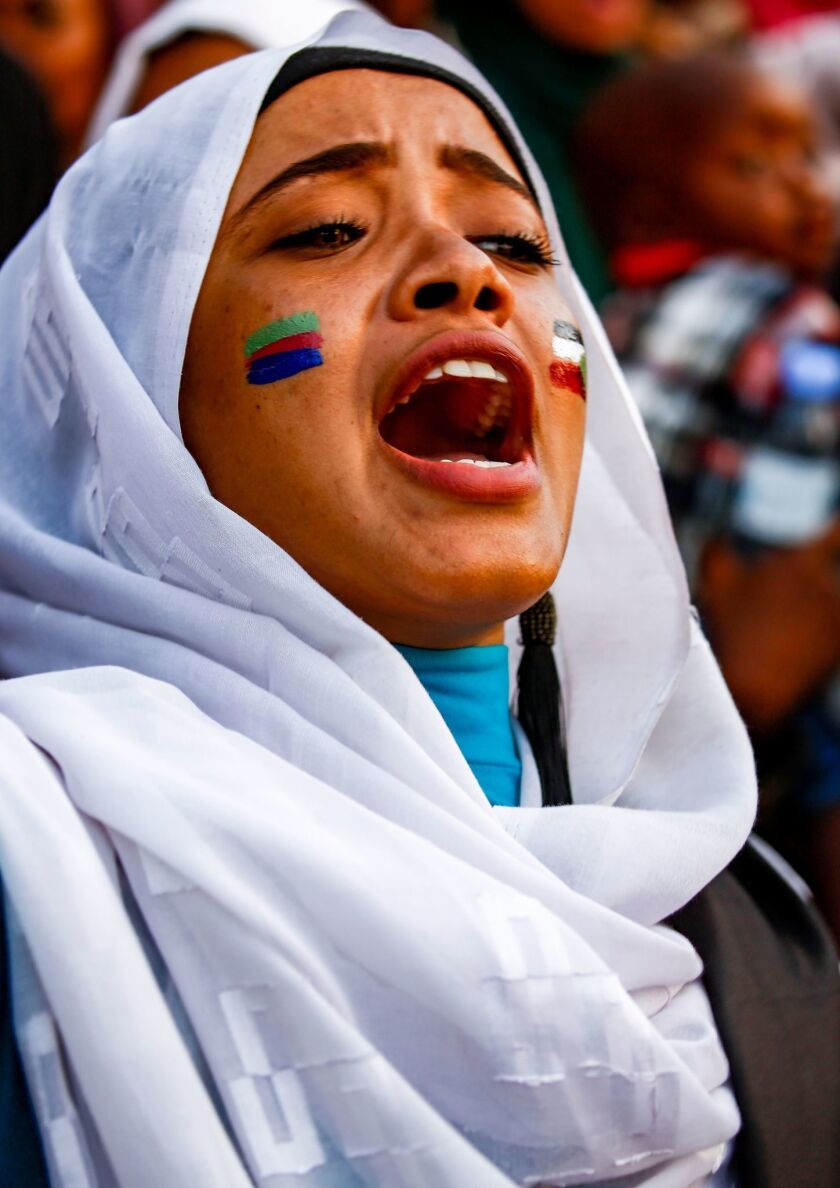 A woman protests Friday outside army headquarters in Khartoum.