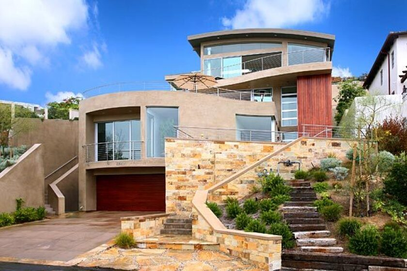 The Laguna Beach contemporary is stepped and set back to reduce the appearance of mass.