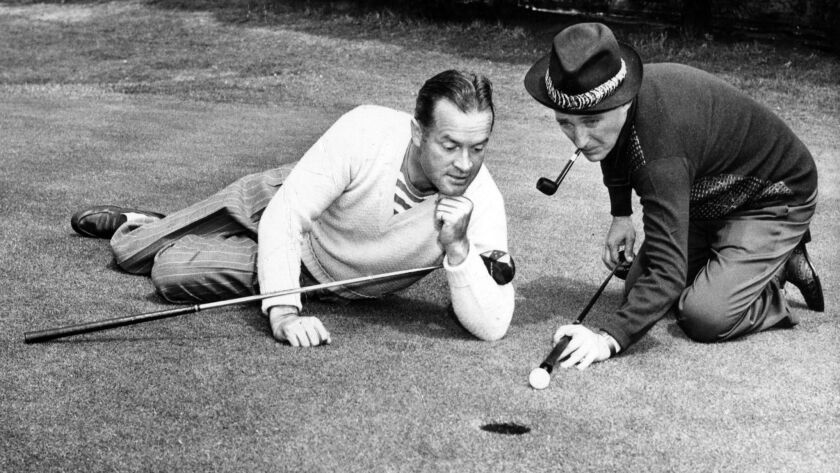 Golf holes or loopholes? Bob Hope admires Bing Crosby's technique in a promotional photo for a golf exhibition.