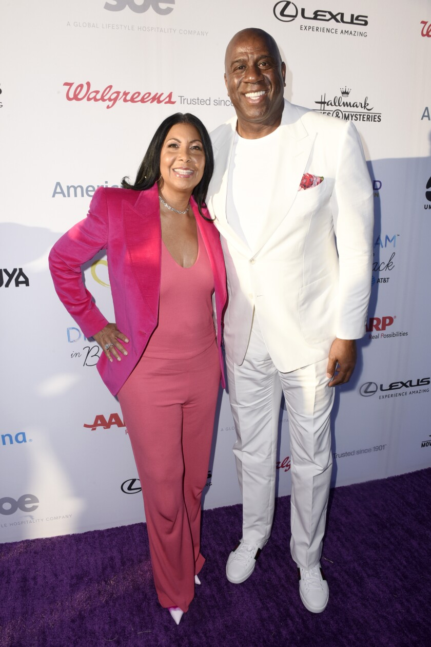 Cookie Johnson, left, and Magic Johnson at the HollyRod Foundation's DesignCare Gala.