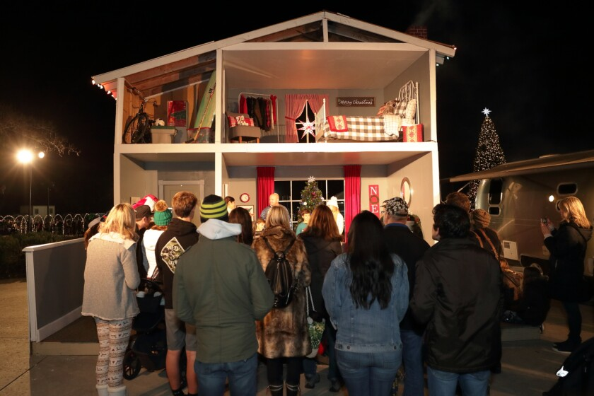 A modern family shares the story of Christmas with their guests