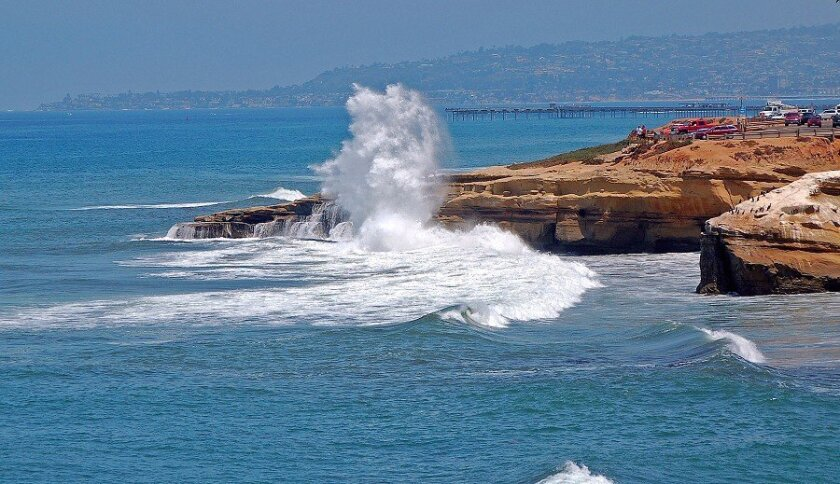The surf pounds the bluffs at Sunset Cliffs Friday afternoon.
