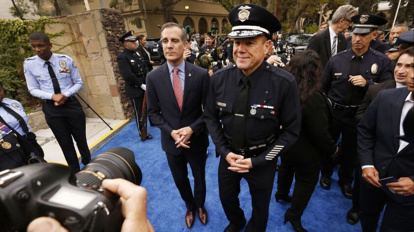 Los Angeles Mayor Eric Garcetti, left, with LAPD Chief Michel Moore, right, in Los Angeles on June 28.