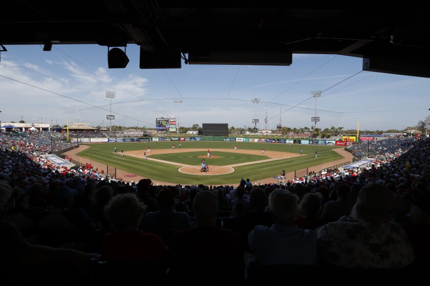 Fans watch a spring training game between the Philadelphia Phillies and Pittsburgh Pirates on March 4 in Clearwater, Fla.