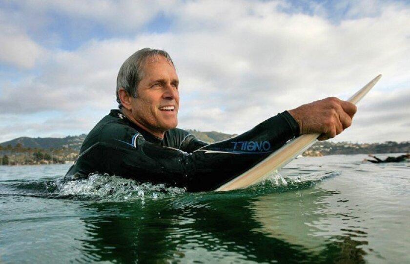 """Gregory Harrison, star of the Playhouse's """"Surf Report,"""" agreed to do an interview — surfing at La Jolla Shores."""