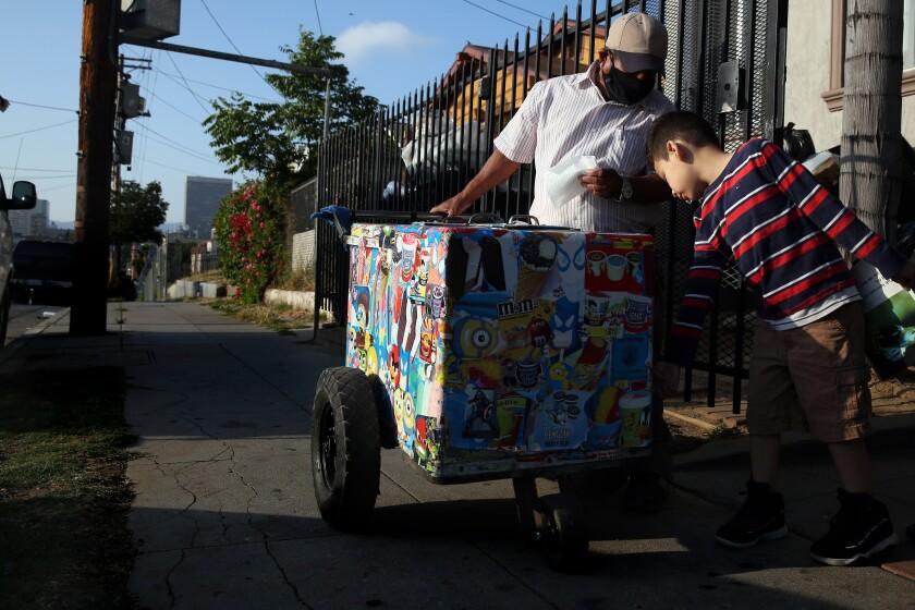 Mauro Rios Parra sells a paleta to Matthew Chicas, 6.
