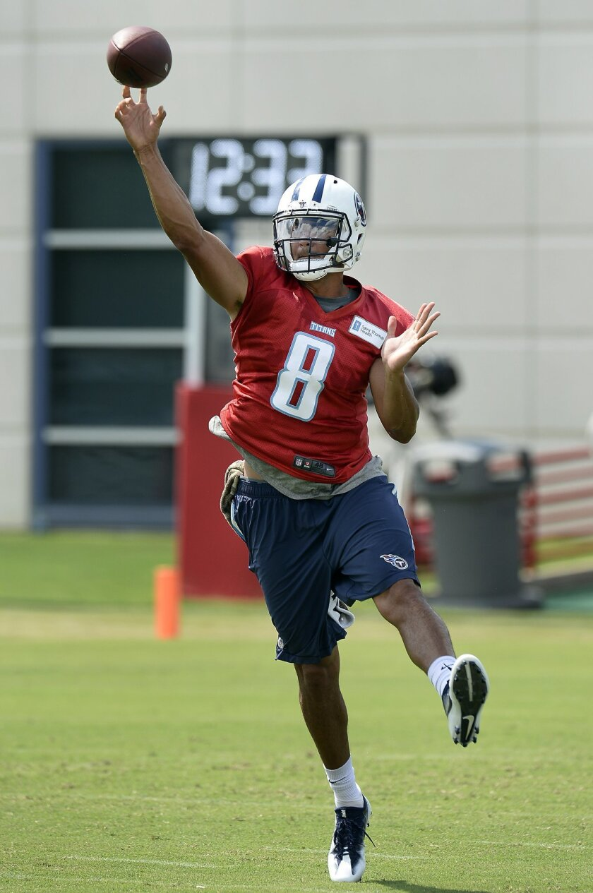 Tennessee Titans quarterback Marcus Mariota passes during NFL football training camp Sunday, July 31, 2016, in Nashville, Tenn. (AP Photo/Mark Zaleski)