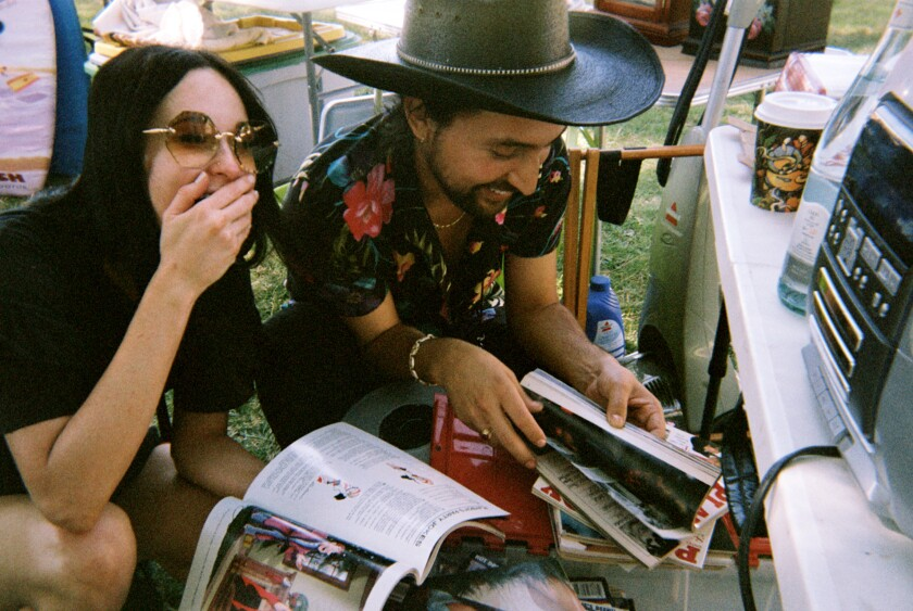 Kacey Musgraves, left, and Giovanni Delgado