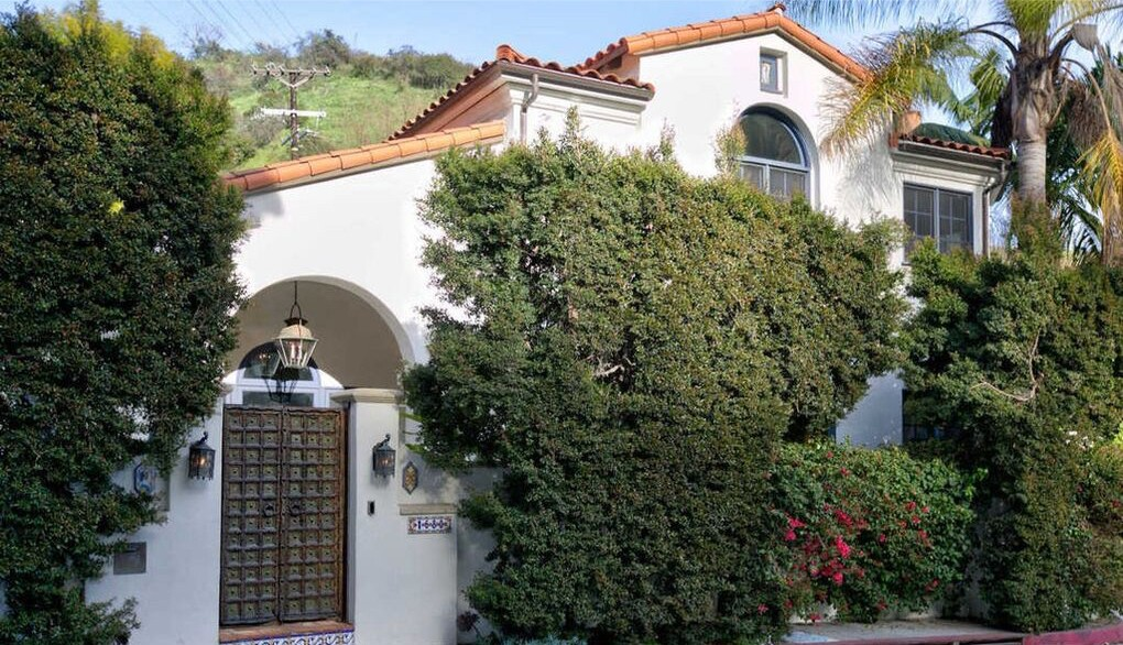 The Mediterranean-style spot includes outdoor spaces such as a courtyard, tiered patio and swimming pool.
