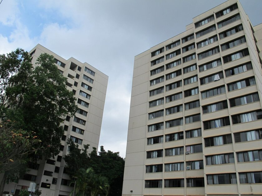 The Hale Wainani dormitory is seen at the University of Hawaii in Honolulu on Monday, Aug. 17, 2015. Two men fell from the 14th floor of the University of Hawaii dormitory, one of them to his death while trying to pull the other from a ledge, Honolulu police said. The 24-year-old man who died was trying to bring inside an apparently distraught 19-year-old who went out a window onto the ledge early Sunday, authorities said. (AP Photo/Jennifer Sinco Kelleher)