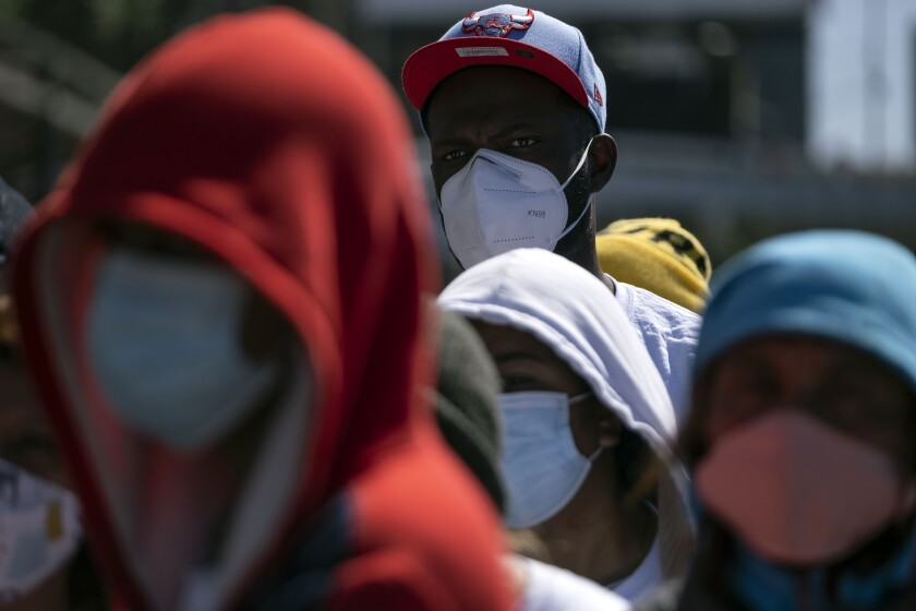 Migrants hold a demonstration at San Ysidro crossing port.