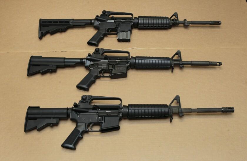 Three AR-15 assault rifles