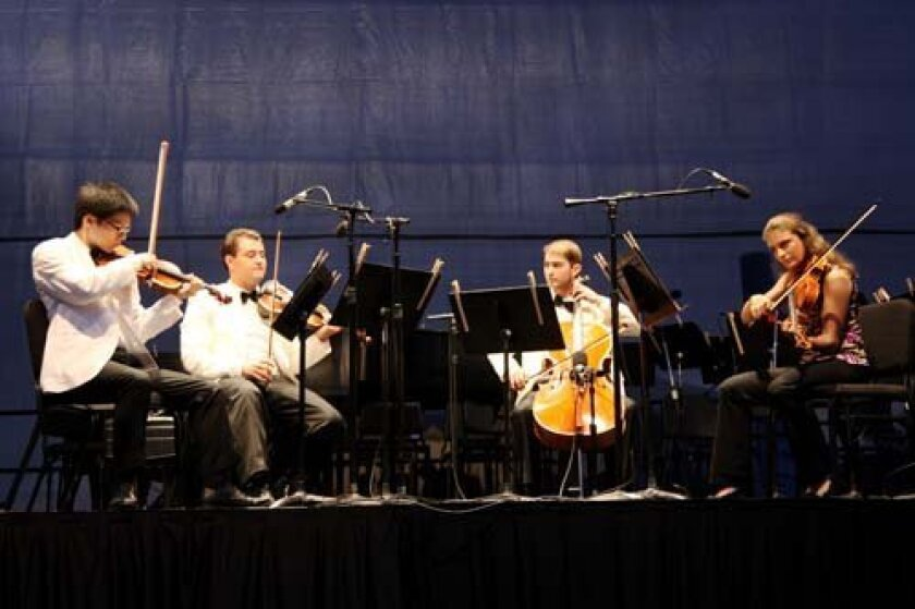 The Old City String Quartet (Bryan Lee, Joel Link, Milena Pajaro-van de Stadt and Camden Shaw) plays Borodin's No. 2 in D Major. Photo: Brittany Comunale