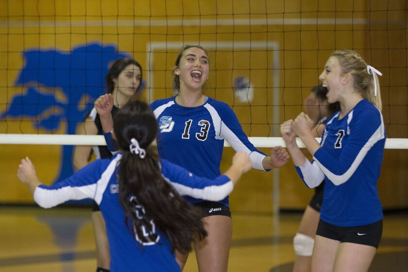 La Jolla Country Day players Shaney Lipscomb (13), Annie Hasselmann (7) and Elise Edman rejoice during last week's SoCal playoff win. The Torreys clinched the Division V State Championship on Saturday.