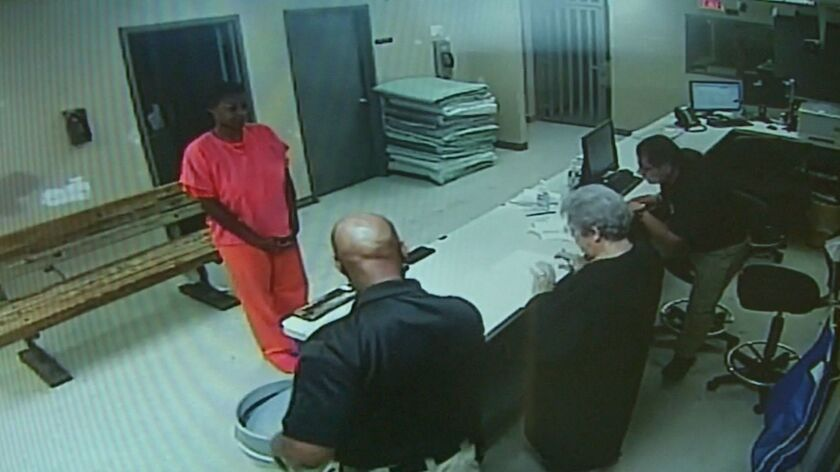 In this undated file frame from video provided by the Waller County Sheriff's Department, Sandra Bland stands before a desk at Waller County Jail in Hempstead, Texas.