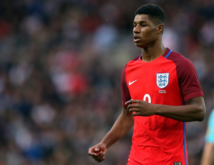 FILE - In this Friday, May 27, 2016 file photo, England's Marcus Rashford runs during the International friendly soccer match between England and Australia at the Stadium of Light, Sunderland, England. Marcus Rashford is going to the European Championship with England, barely three months after the