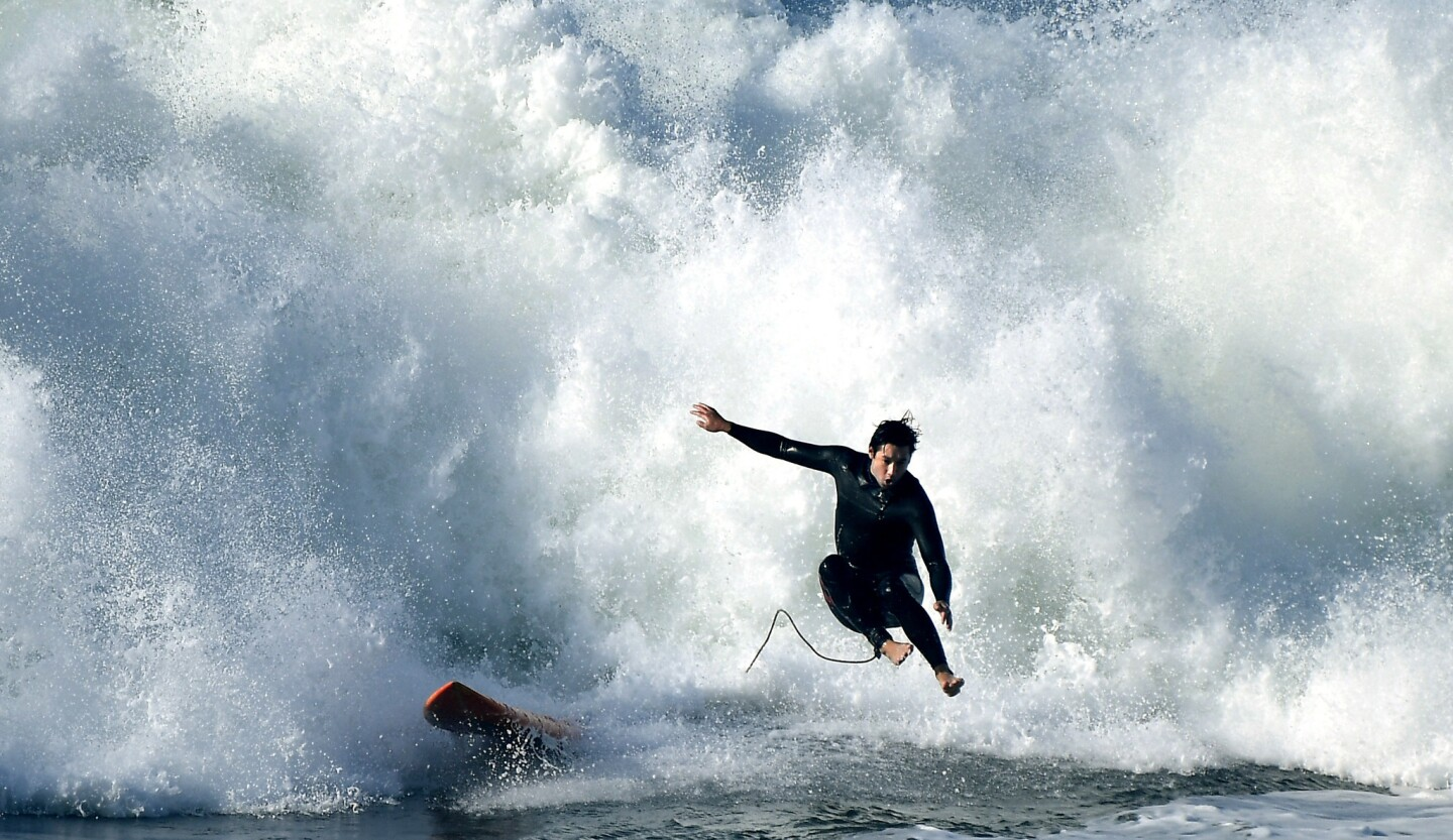 A surfer bails-out on a huge wave in Palos Verdes as high surf continues to pound the coast.