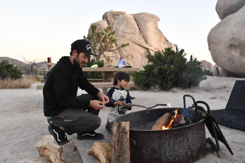 Cory McPherson and son Benjamin roast a marshmallow in the Hidden Valley Campground at Joshua Tree National Park.