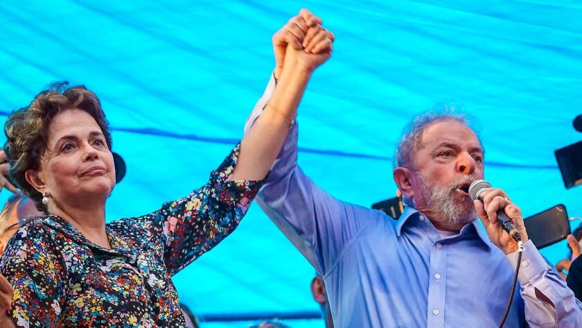 Former Presidents Dilma Rousseff and Luiz Inacio Lula da Silva greet supporters in Porto Alegre, Brazil, on Jan. 23, 2018. Rousseff was impeached and Lula was convicted of corruption.