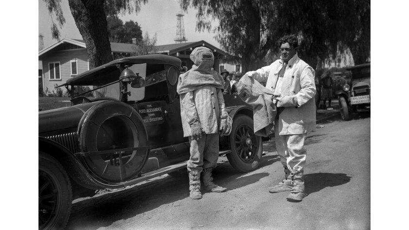 Sept. 19, 1928: Ford Alexander, right, and his unidentified brother wear special asbestos firefighti