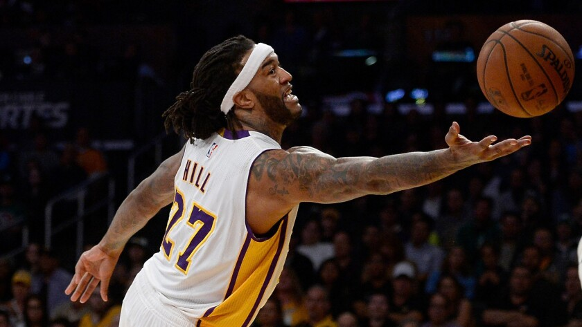 Lakers forward Jordan Hill reaches for a rebound during a win over the Boston Celtics on Feb. 22, 2015.