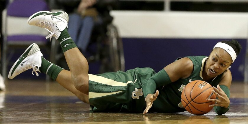 Baylor's Odyssey Sims recovers a loose ball during the first half of an NCAA college basketball game against Kansas State Thursday, Jan. 2, 2014, in Manhattan, Kan. Sims scored 40 points leading Baylor to a 92-63 win. (AP Photo/Charlie Riedel)
