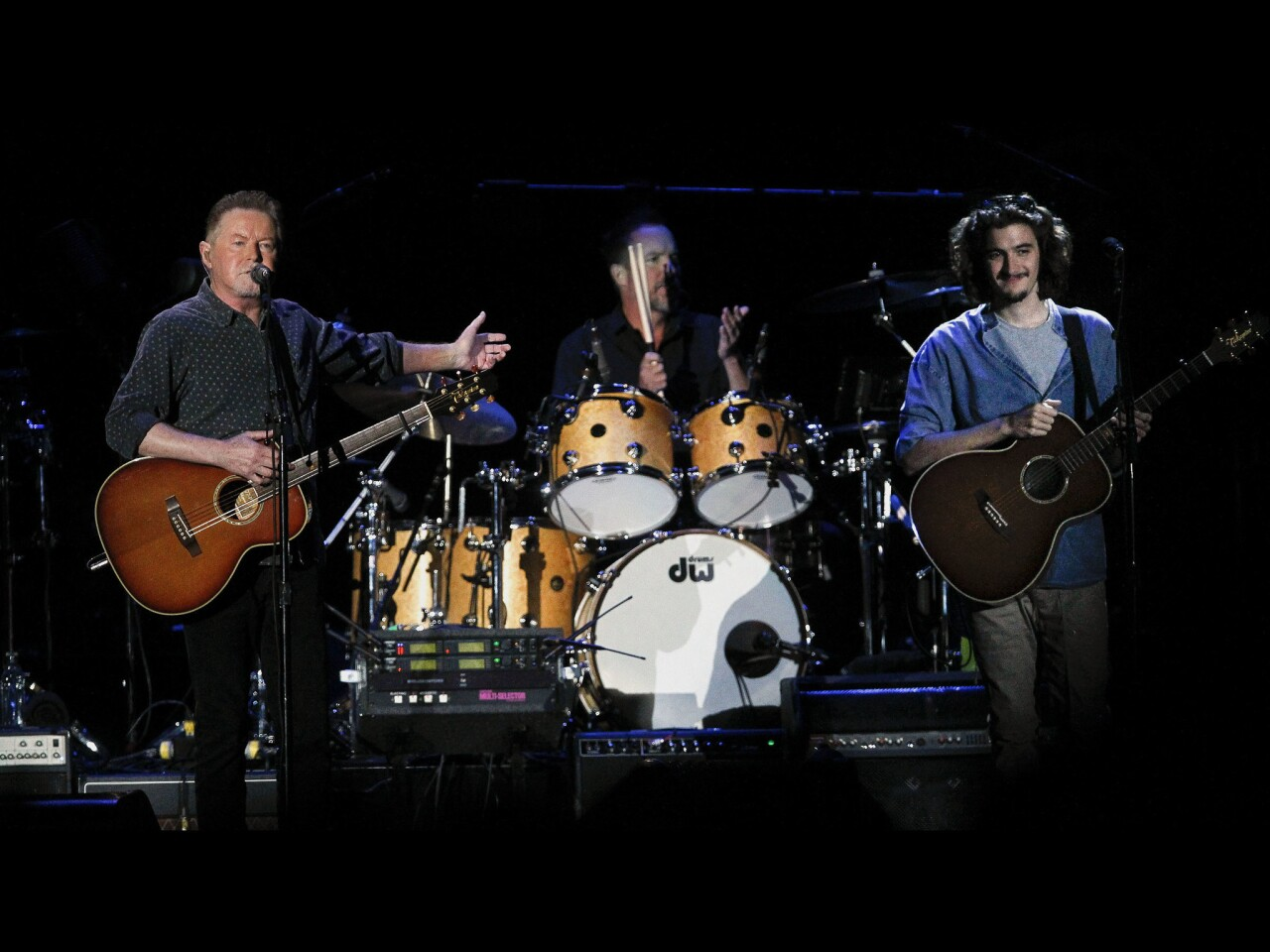Don Henley, left, introduces Deacon Frey, son of Glenn Frey, during the Eagles concert at Petco Park.