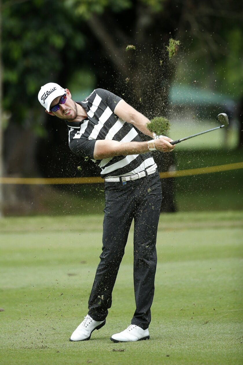 Nathan Holman of Australia hits a shot during day two of the Maybank Championship golf tournament in Kuala Lumpur, Malaysia, Friday, Feb. 19, 2016. (AP Photo/Vincent Thian)