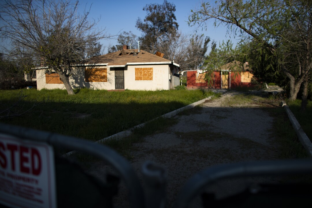 Boarded-up homes in Fontana will be replaced by warehouses.