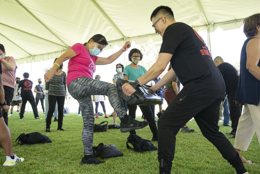Wan Palachan practices her kicking skills