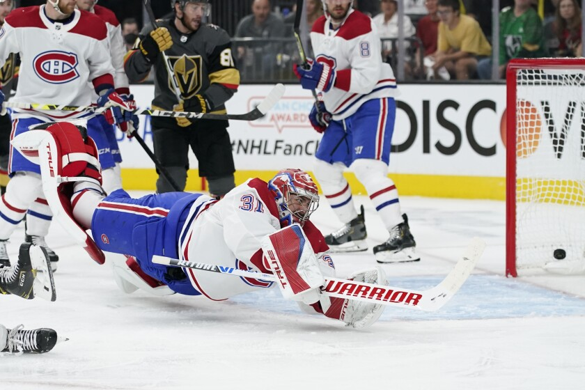 Montreal Canadiens goaltender Carey Price (31) is scored on by Vegas Golden Knights defenseman Alec Martinez, not pictured, during the second period in Game 1 of an NHL hockey Stanley Cup semifinal playoff series Monday, June 14, 2021, in Las Vegas. (AP Photo/John Locher)