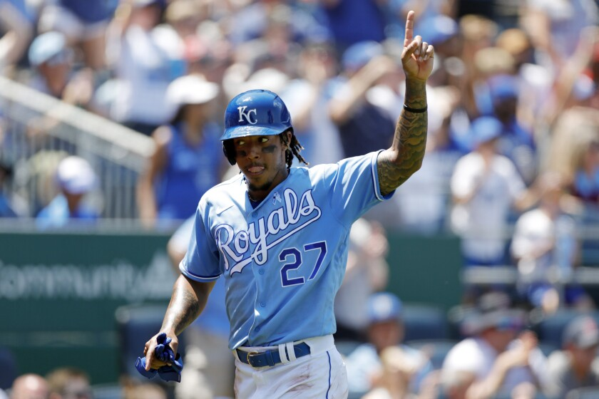 Kansas City Royals' Adalberto Mondesi reacts after scoring off a Jarrod Dyson double in the third inning of a baseball game against the Boston Red Sox at Kauffman Stadium in Kansas City, Mo., Sunday, June 20, 2021. (AP Photo/Colin E. Braley)