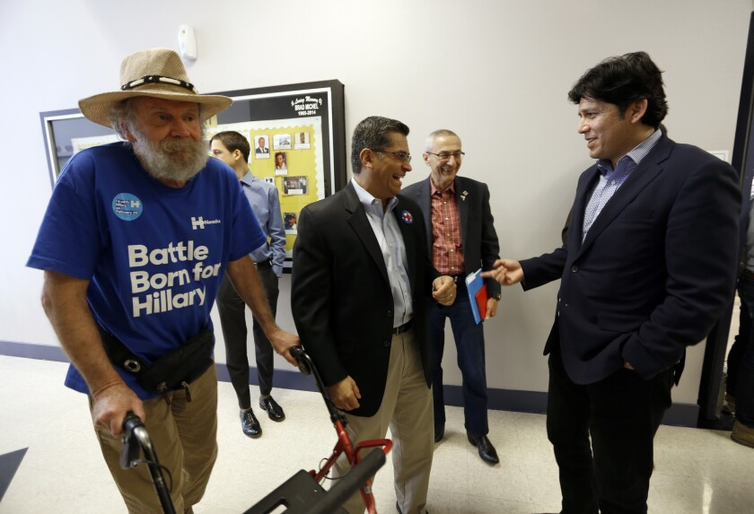 U.S. Rep. Xavier Becerra (D-Los Angeles), center, will leave his congressional seat after 24 years if confirmed as California's next attorney general. State Senate leader Kevin de León (D-Los Angeles), right, has said he won't run to replace him.