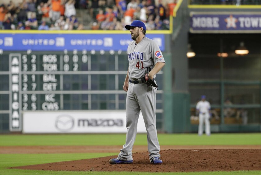 Chicago Cubs starting pitcher John Lackey reacts after giving up a home run to Houston Astros' Alex Bregman during the third inning of a baseball game Saturday, Sept. 10, 2016, in Houston. (AP Photo/David J. Phillip)