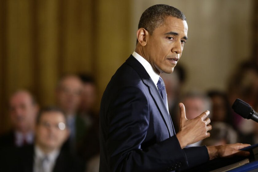 Obama signals he's putting climate change on back burner