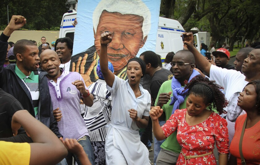 Mourners gather Friday outside the Johannesburg home of former South African President Nelson Mandela following the announcement of his death.