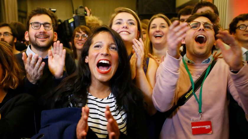 Supporters of Benoit Hamon celebrate at a gathering in Paris after their candidate won the Socialist Party presidential nomination on Sunday.