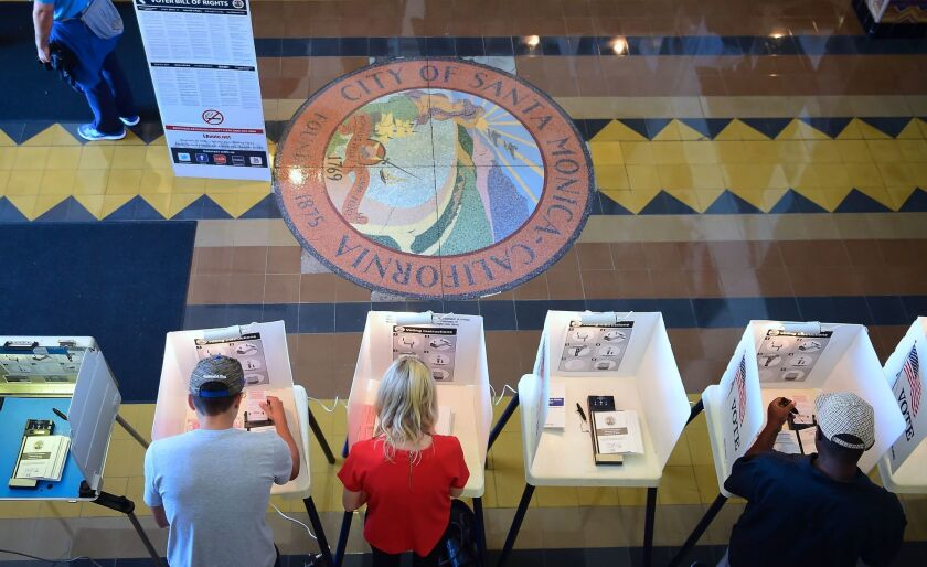 Voters cast their ballots in Santa Monica City Hall.