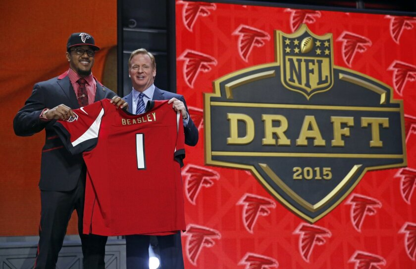Clemson defensive lineman Vic Beasley poses for photos with NFL commissioner Roger Goodell after being selected by the Atlanta Falcons as the eighth pick in the first round of the 2015 NFL Draft,  Thursday, April 30, 2015, in Chicago. (AP Photo/Charles Rex Arbogast)