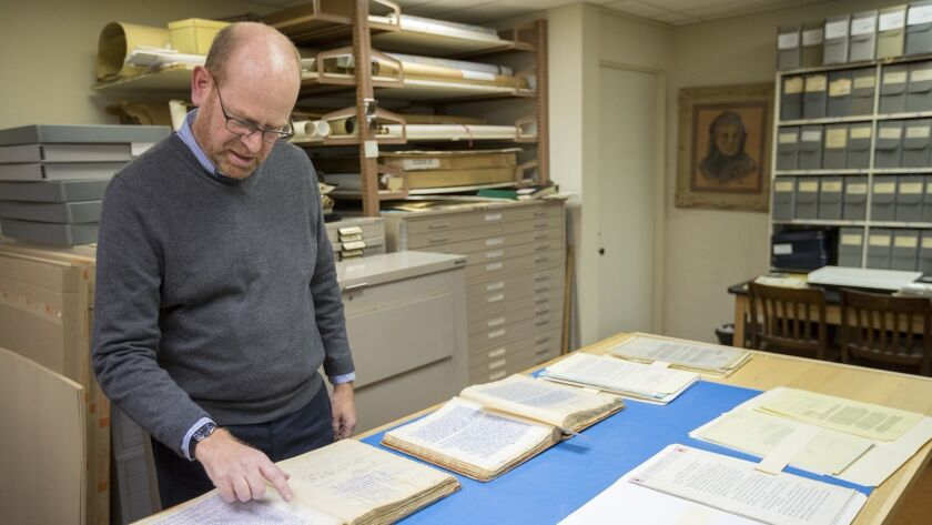 Library Director Paul Wormser looks over historical documents at the Sherman Library on Friday, Febr