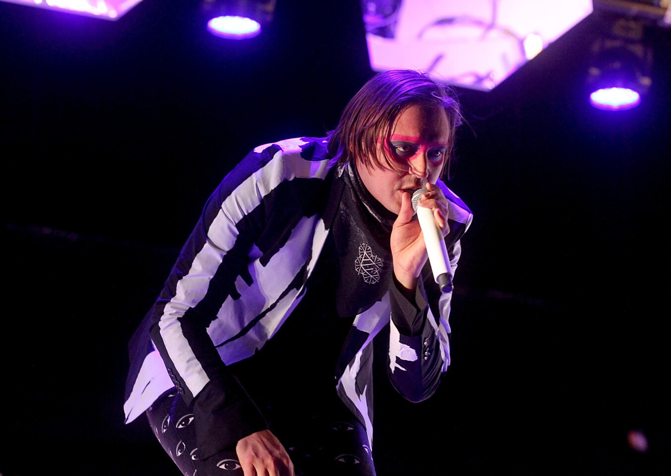 Arcade Fire lead vocalist Win Butler performs on the main stage on the third night of the Coachella Valley Music and Arts Festival in Indio.