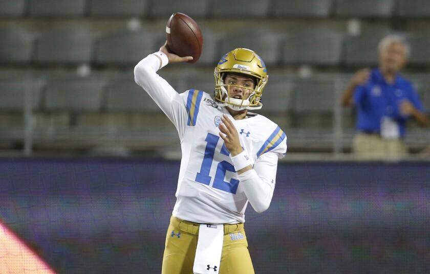 UCLA quarterback Austin Burton passes against Arizona.